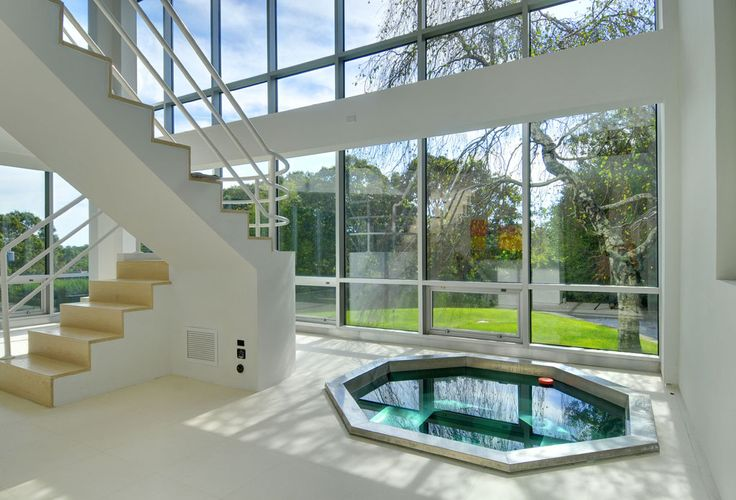 28 Clamshell Avenue, East Hampton, Long Island: Stunning and one of a kind. This is the glass box everyone has been waiting for. Minimalism at its best. Large master bedroom suite and 3 additional guest bedrooms, four baths and two half baths, steam shower. Two entertaining spaces, glass and stainless steel kitchen, adjacent separate dining room with wall mounted fireplace. Limestone floors. Sauna, hot tub and gunite pool surrounded by river rocks. Attached two car garage.