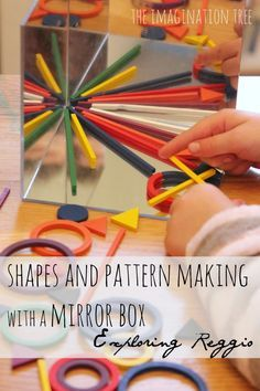 Playing with shapes and symmetry on a mirror box - from the imagination tree. This uses acrylic mirror tiles - what a great idea.