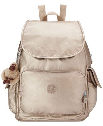 Obsessed with the metallic shimmer on this Kipling backpack