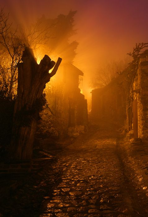 Goth:  #Grim #street ~ night photography with fog and uncorrected lighting.