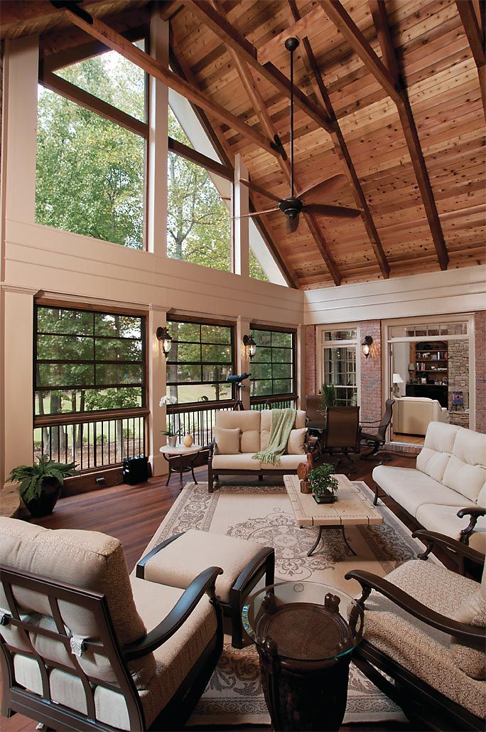 Three season porch with Eze-Breeze® windows and high gable ceiling. Back porch designed and built by Atlanta Decking & Fence.