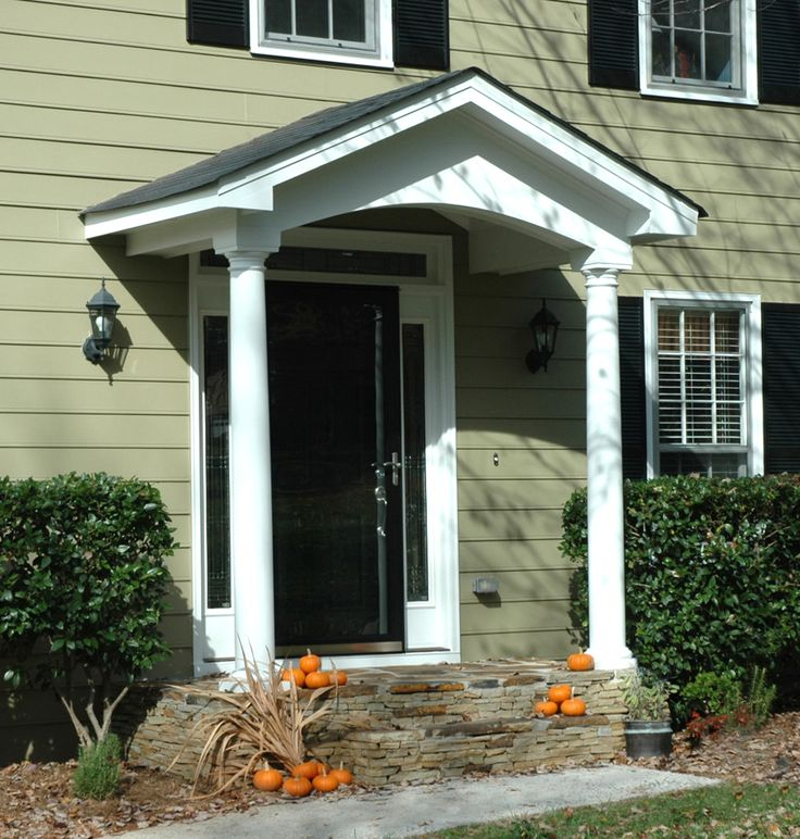Simple portico for clapboard sided home designed by for House plans with portico