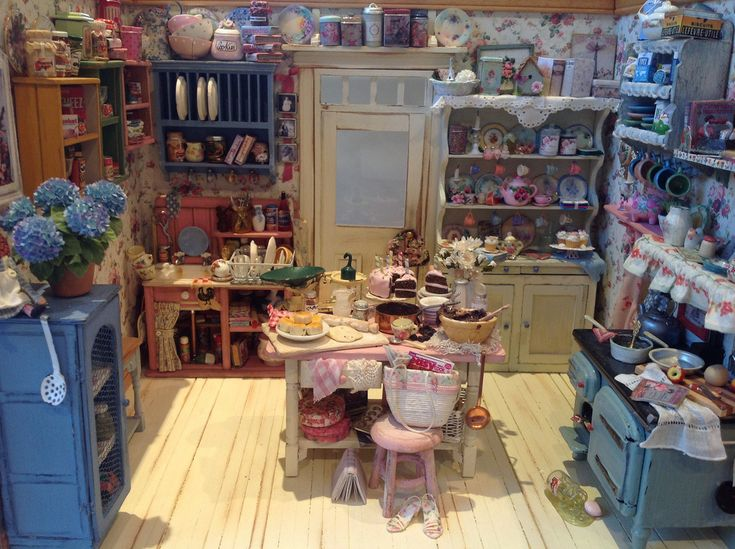 Here is a photo of my dollhouse size shabby chic kitchen! I've been collecting for this room box for about three years.  I really love this tiny kitchen! It's cluttered which was always the intention but I think it feels warm and cosy!