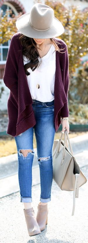 slouchy maroon jacket and a hat.
