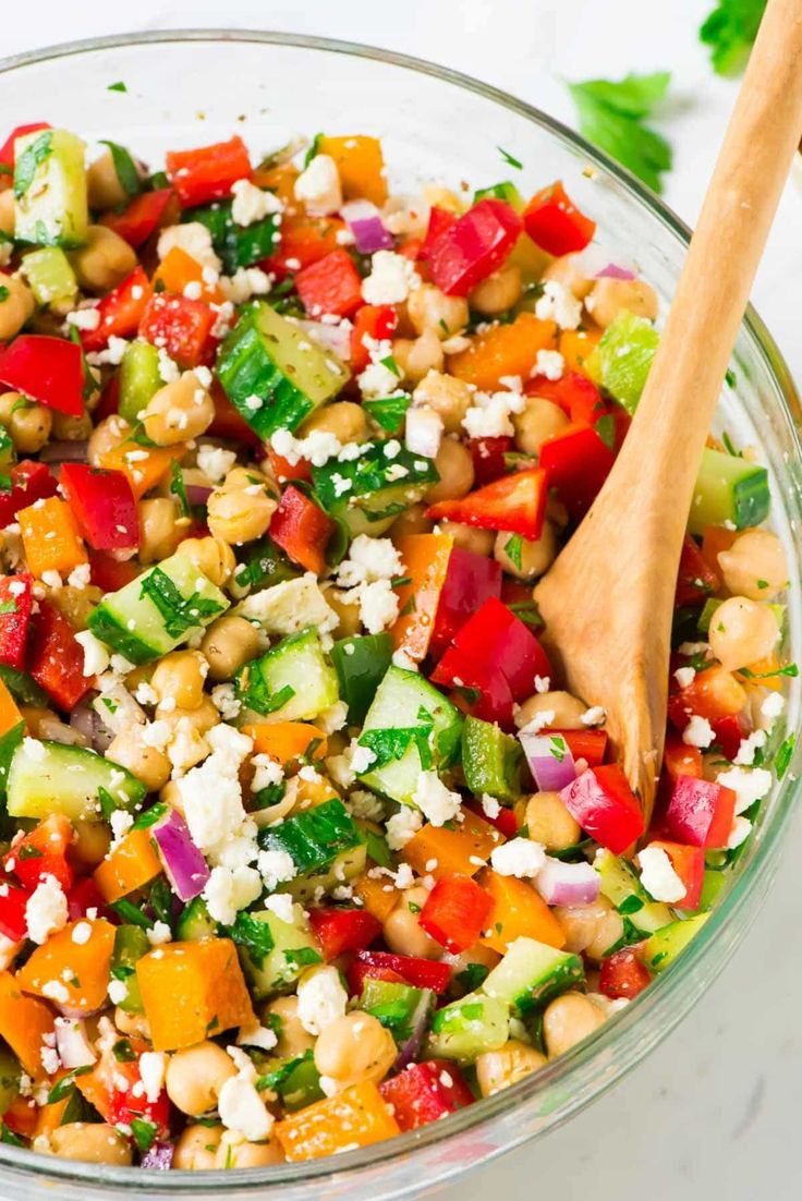Easy and healthy Mediterranean Chickpea Salad with Feta, Cucumber, Bell Pepper, and Red Onion. Perfect for easy entertaining, light summer meals, and picnics or barbecues. Recipe at wellplated.com | @wellplated
