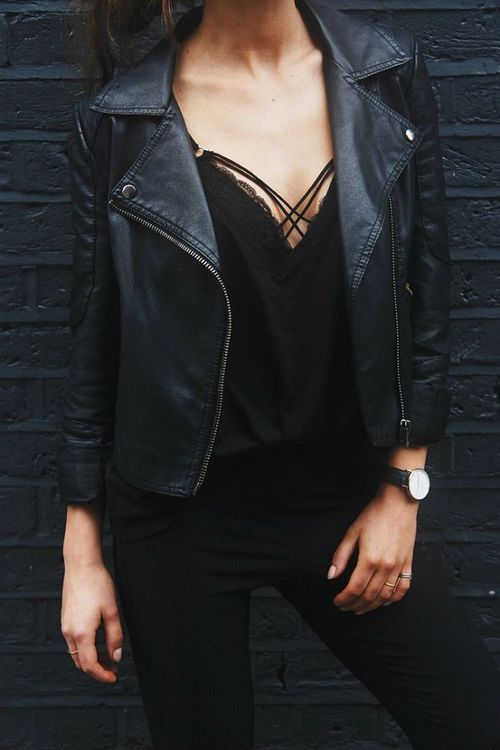 Monochrome black is so stylish. We love this black tank paired with a black leather jacket and jeans accessorized with a watch.