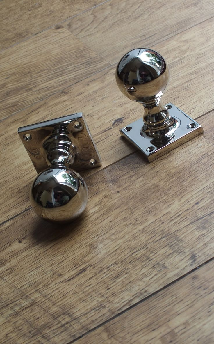 """A set of polished nickel """"Ball"""" door knobs ounted on a square rose from British Ironmongery. Ball knobs are one of the most traditional styles of door knob we sell and available in different sizes and finishes. Each one is made in the UK, individually finished by hand and available in over twenty finishes and metals. Available from - http://www.britishironmongery.co.uk/shop/ball-door-knob-on-square-rose/854.htm"""
