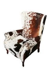Nguni cow hide wingback chair. Nguni cattle are endemic to South Africa. The cattle are revered in all the southern African tribes.