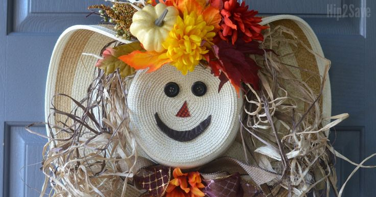 Grab a straw hat and learn how to make this unique Fall Scarecrow Wreath!
