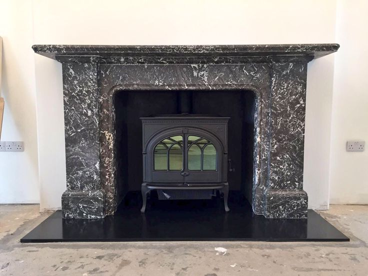 Jotul F600 in a huge original fireplace installed in Inverness by Greenbrae Stoves of Inverness and Hopeman.