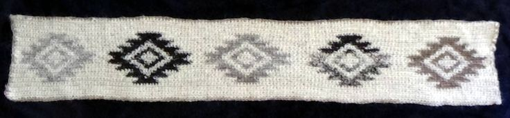 Crocheted border.   Motive from Navajo rugs.