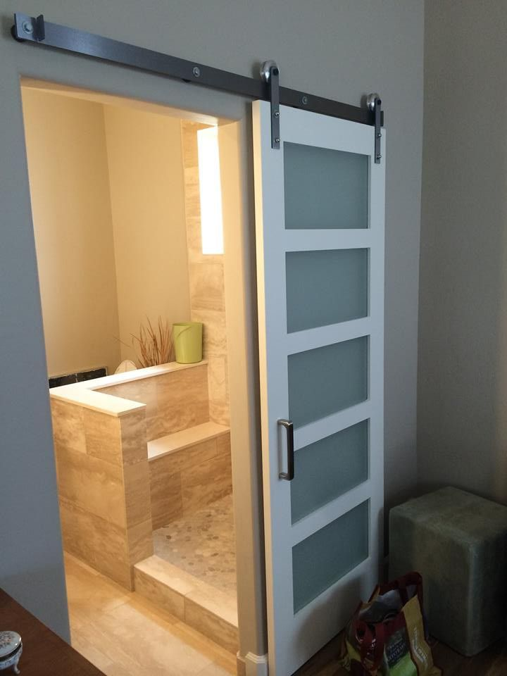 This satinetched glass contemporary barn door with