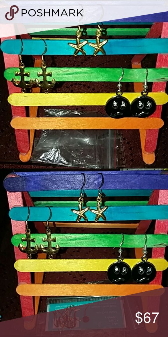 Earrings for sale $6 Gold seashell and starfish  $17 Black and silver face earrings  Comes in package Ziploc or sticky plastic seal Jewelry Earrings