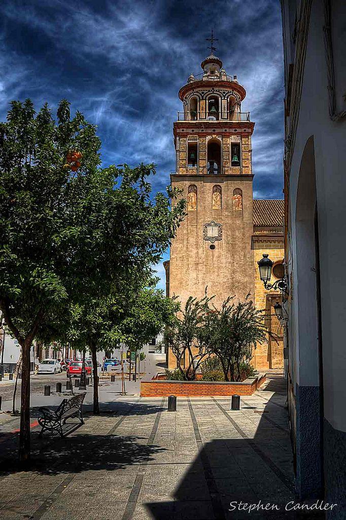 Church along de street in Sanlucar de Barrameda, Andalusia_ Spain