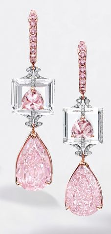 RARE AND EXQUISITE PAIR OF FANCY INTENSE PURPLE-PINK DIAMOND, PENDENT EARRINGS Suspending a pear-shaped fancy intense purple-pink diamond weighing 4.01 carats and a fancy intense purplish-pink diamond weighing 3.72 carats, surmount
