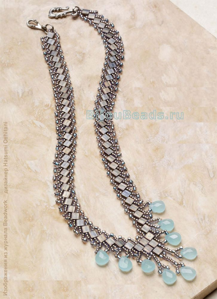 Silver necklace track of beads and beads tila