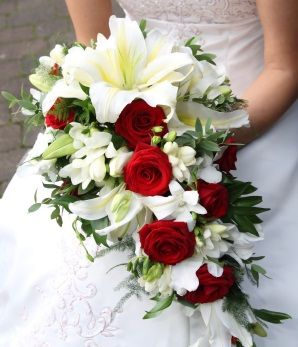 wedding flower arrangments with lilies and red roses | cascading bouquet of red and white. White lilies, red roses ...
