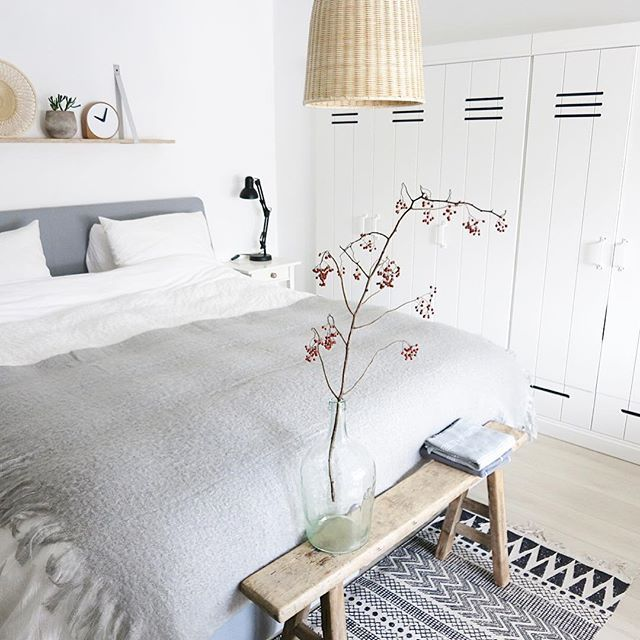 Quiet grey and white bedroom with some natural elements.