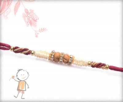Buy Online Rakhi - #Designer #Sandalwood #Diamond #Rakhi, Sandwood Diamond Zardosi Rakhi, surprise your loved ones with roli chawal, chocolates and a greeting card as it is also a part of our package and that too without any extra charges. http://www.bablarakhi.com/