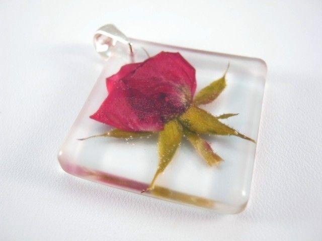 Flower of Rose preserved in resin.  http://en.dawanda.com/product/45687506-Anhaenger---Rose---925-Silber