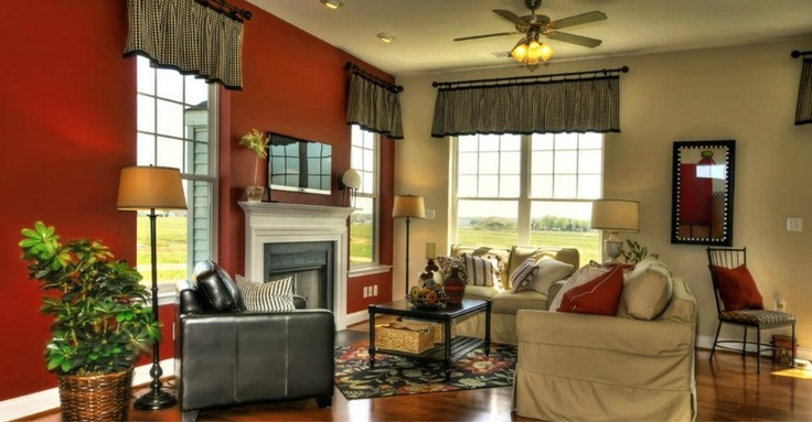 "The Harrison: Living Room with Standard 36"" Fireplace with Slate Surround and Tilt-Mounted 46"" Sony Flat Screen TV"