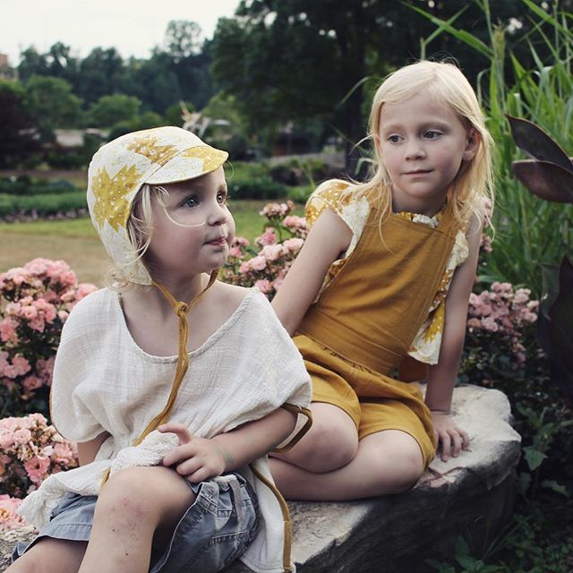 ~ Tres Chic ~ An Evergreen Bonnet and Pixie Romper form part of this very casually stylish shot... You could almost imagine these beauties lounging in a Parisian park 👌🏻🌳 📷 @smgajus