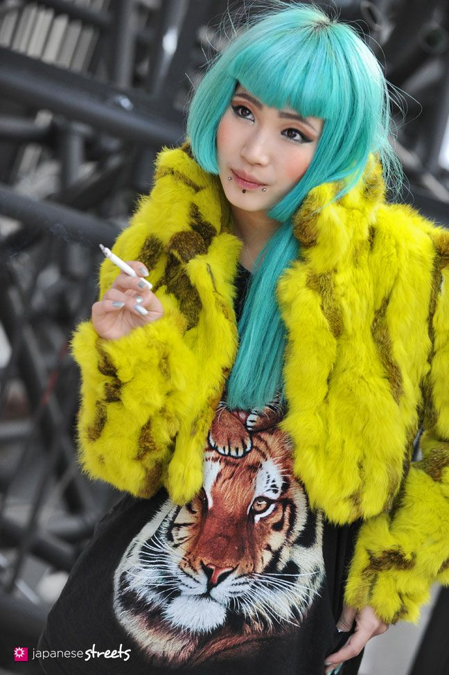 Cool and stylish.  Smoking in all senses.   Japanese street fashion in Harajuku, Tokyo