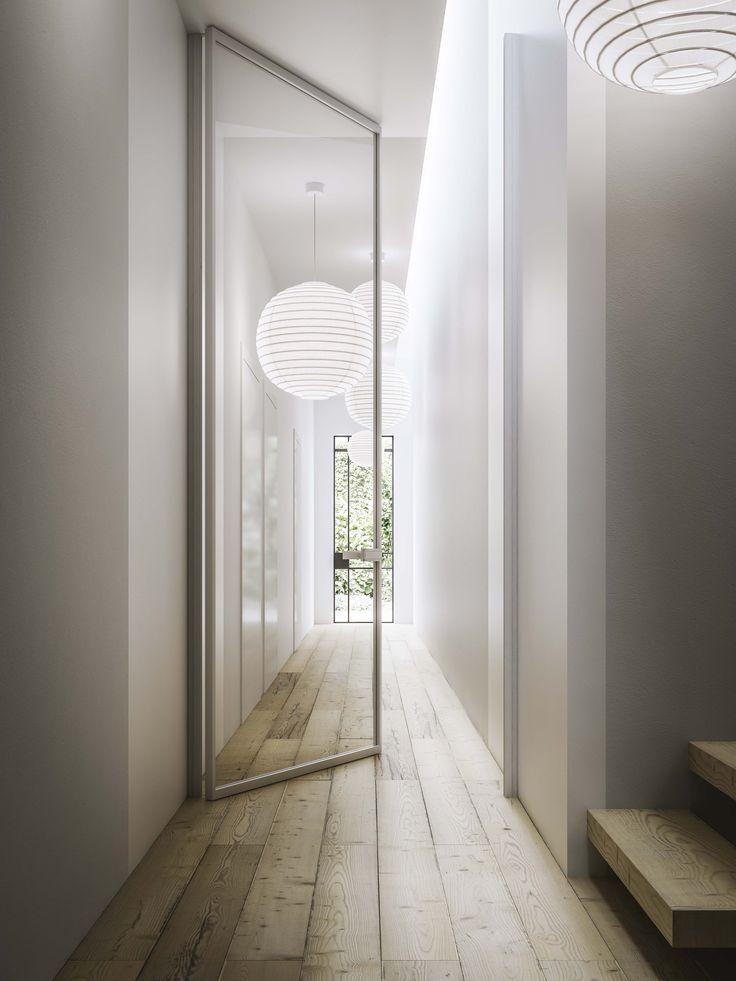 porta a bilico in alluminio e vetro con stipite esterno muro su due lati. applicazione speciale per corridoio