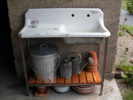 OMG!  I have one of these old sinks.....now I know just what to use it for- the perfect potting bench!!