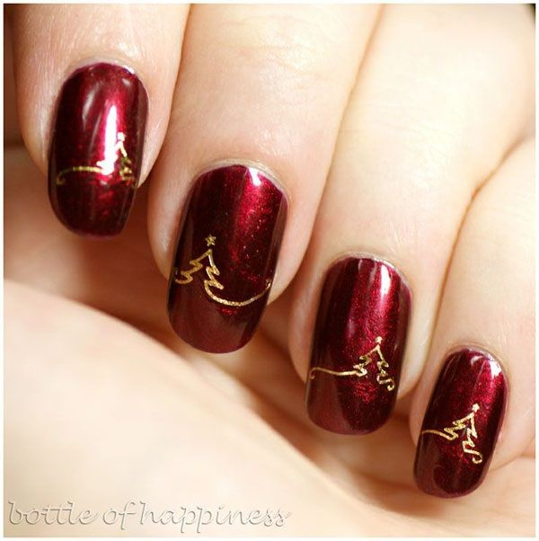 Paint your nails bloody red with gold with this Christmas nail art design. Paint on matte red polish on your nails. Then add details of Christmas trees on the mountains. A real simple but eye catching design.