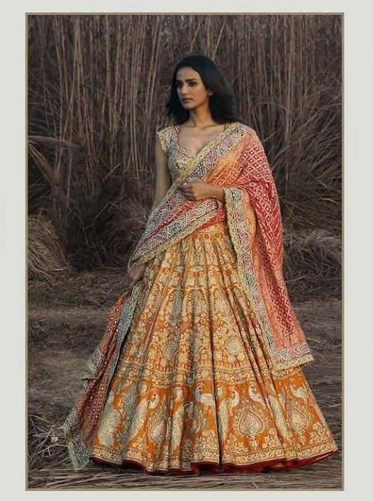 c6e7a22283 Yellow ochre silk Lehenga-Choli with beautiful embroidery embellishments.  Floral and traditional embroidery with hand work and resham Ari work and  zardose.