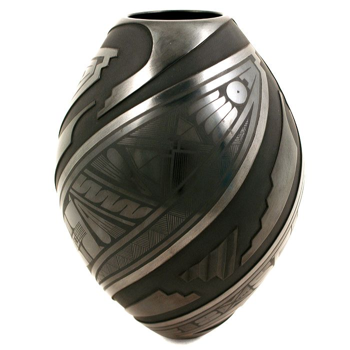 Magnificent black on black etched , carved and painted olla by Mata Ortiz artist Salvador Baca. This tall beauty is a great example of Salvador's talent and superb craftsmanship.    Salvador just won the Gran Premio de Arte Popular - Grand Prize of Popular Art, a national award competition in Mexico! $595.00