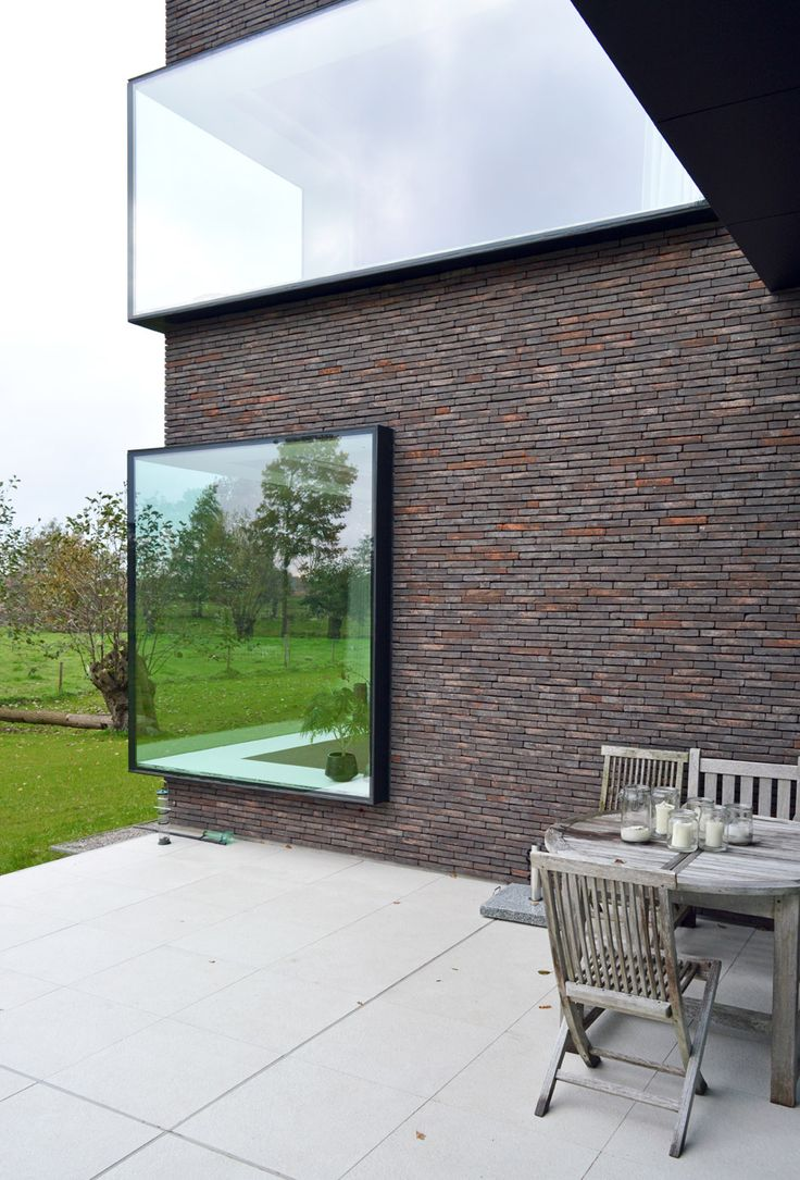 Belgian house with large protruding windows, which provide wide ledges for display ceramics