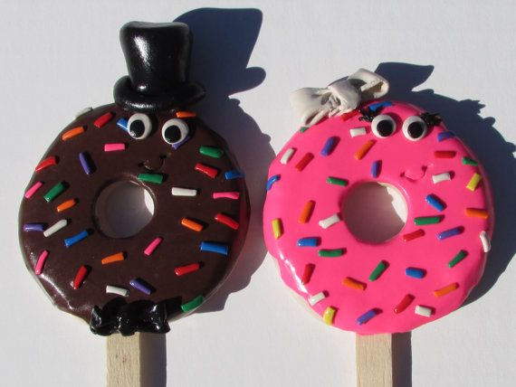 Check out this item in my Etsy shop https://www.etsy.com/listing/253790599/doughnut-bride-groom-wedding-cake-topper