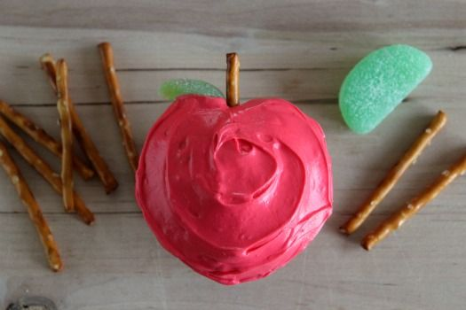 Supplies for Apple Shaped Cupcakes:    cupcake mix  cupcake liners and muffin tin  marbles or tinfoil  red colored frosting  pretzel sticks  green gumdrops