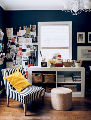 A vintage chair goes mod in a bold black and white stripe and the sunny yellow pillow is the ultimate finishing touch | domino.com