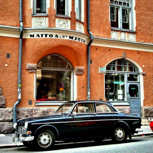 old Volvo and colorful architecture