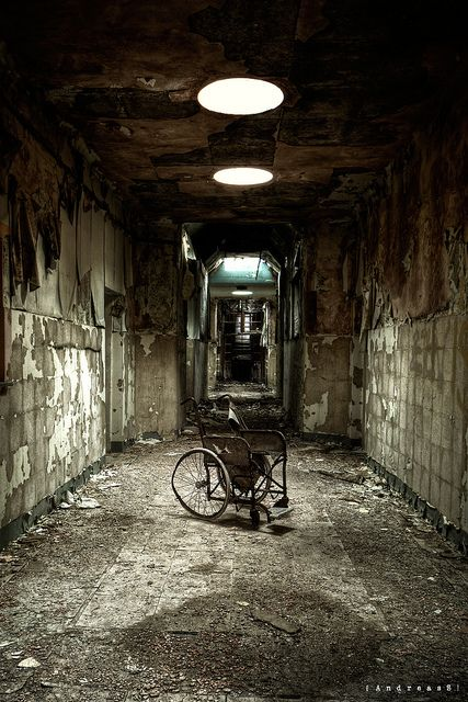 Wheelchair in asylum D (UK). The place closed down in the late 1990s, after being open for 150 years - By [AndreasS] via flickr