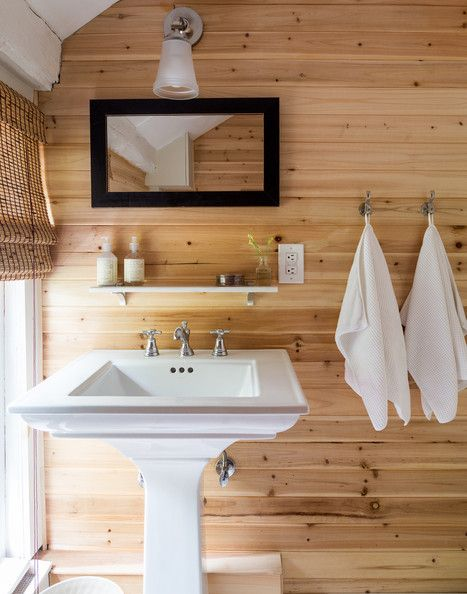 A country bathroom with pine plank-covered walls | Lonny.com