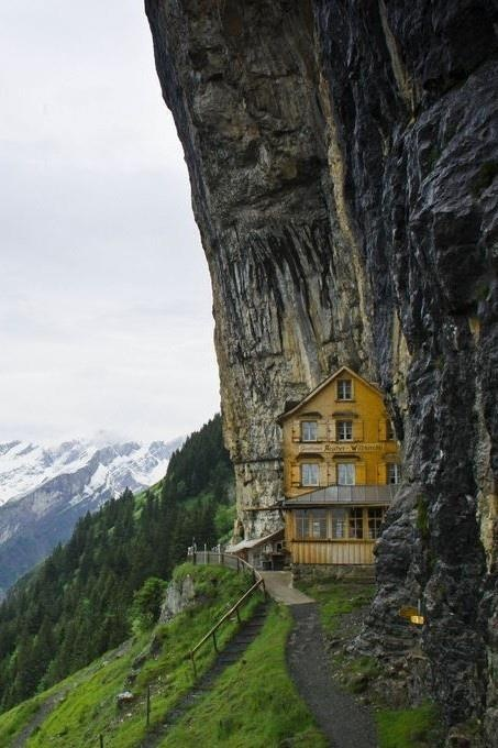 The mountain house Aescher Wildkirchli is built right into a cliff face