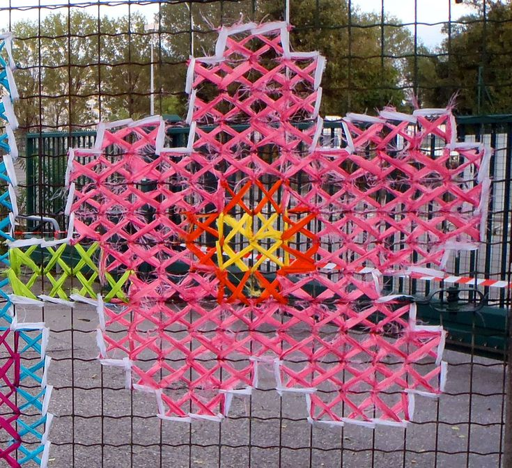 These Artists Have Discovered A New Type Of Street Art—Cross-Stitching On Fences