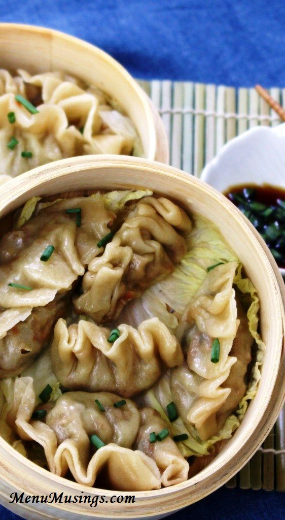 Steamed Asian Dumplings - Step-by-step tutorial plus video link to making these delicious dumplings.  Steaming is a totally fat free step, and you can add as many healthy veggies as you want!  Even my oldest, who won't go near a vegetable, loved them!!
