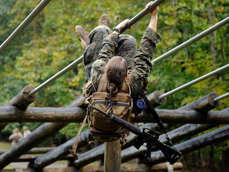 A female Marine pulls herself through an obstacle course during the combat endurance test on Aug. 28, 2012, in Quantico, Va. This is the first event in the Marine infantry officer's course.