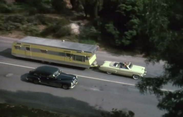 "Lucy and Ricky in ""The Long, Long Trailer"". 1953 Mercury Monterey convertible and 36-foot New Moon Travel Trailer"