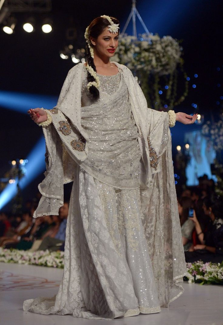 The Pakistani Bridal Couture week just wrapped up in Karachi, Pakistan and as usual, it was spectacular.  Last year, we covered the major designers from Fahad Hussayn to Nomi Ansari to uber lux The House of Kamiar Rokni.  This year we will be covering our favorite wedding outfits from all the designers under one piece.    HSY went for an elegant, bridal look  [...]