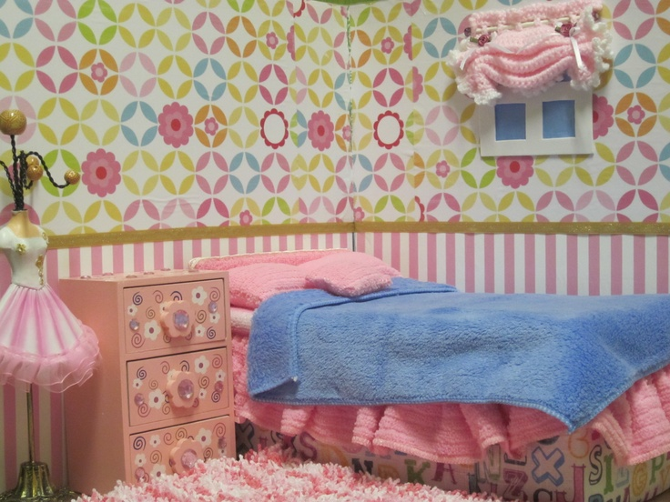 the bedroom with crocheted curtain, cardboard box bed, knitted rug and various Dollarama Store accessories