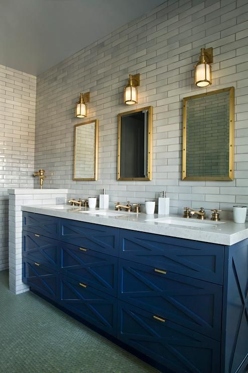 Contemporary shared boys' bathroom features a blue washstand adorned with blue x front drawers adorned with brass pulls is topped with white quartz fitted with three sinks and three brass faucets placed under three brass Restoration Hardware Rivet Medicine Cabinets illuminated by brass sconces.