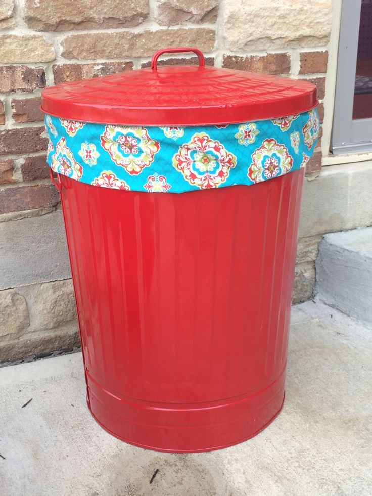 Easy, inexpensive outdoor toy and game storage. Galvanized steel trash can spray painted with rust resistant color for a pop of color on the patio. I added a trim of fabric for a little something extra!