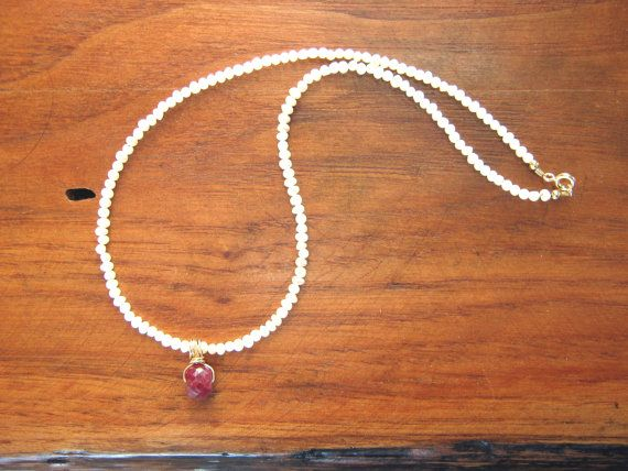 Balinese ruby pendant on a string of seed by MariaTepperJewelry