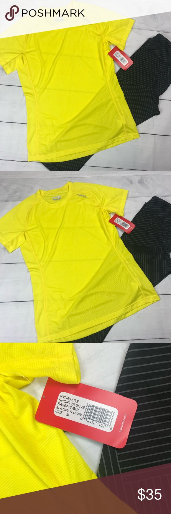 """Saucony Women's Hydralite Short Sleeve Run Shirt Saucony.  Women's Medium.  Brand new with tags.  Hydralite short Sleeve workout running shirt.  Blazing yellow color! Very nice!  This is the best Tee shirt for any type of athletics.  Excellent quality.  Reflective logo for night  50% recycled polyester 50% polyester  Pit to pit 17"""" Length 25"""" Tops Tees - Short Sleeve"""